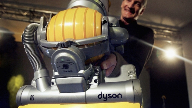 LONDON - MARCH 14: Inventor James Dyson demonstrates his latest hoovering invention on March 14, 2005 in London. The vaccum cleaner replaces the traditional four wheels with one ball to guide it across the floor giving it increased maneouverability. (Photo by Bruno Vincent/Getty Images)
