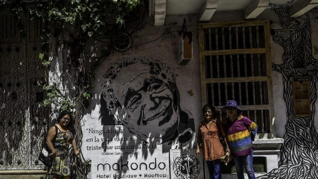 Tourists in front of a mural depicting the late Colombian writer and Nobel laureate Gabriel Garcia Marquez in Cartagena (photo: Getty images)