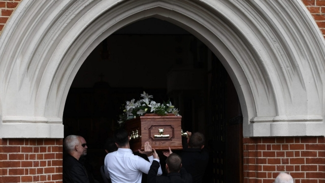 A coffin is carried into a church during a funeral on 29 June 2017 in London, England. Mortality rose in early 2018 in England and Wales.