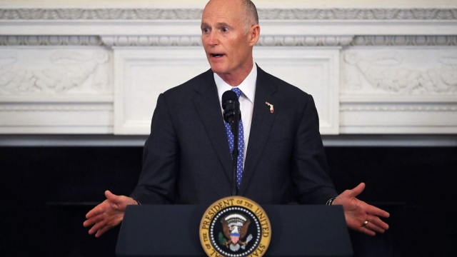 Florida Governor Rick Scott, an NRA member, signed the historic bill. Photo: Getty