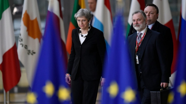 Theresa May is half-way through the formal Brexit process (Photo credit: JOHN THYS/AFP/Getty Images)