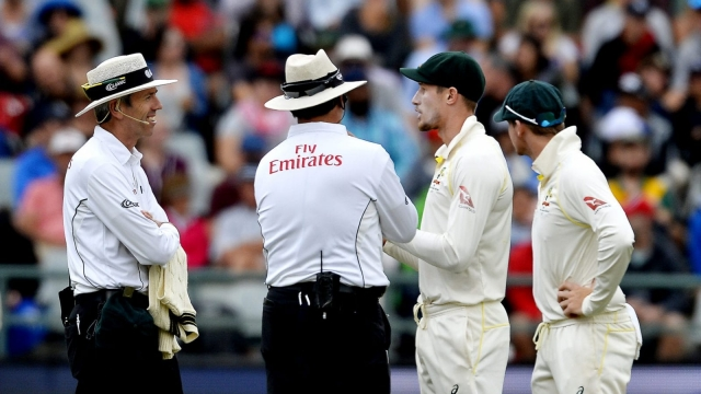 Umpires chatting with Cameron Bancroft and Steven Smith of Australia about ball tampering on 24 March 2018.