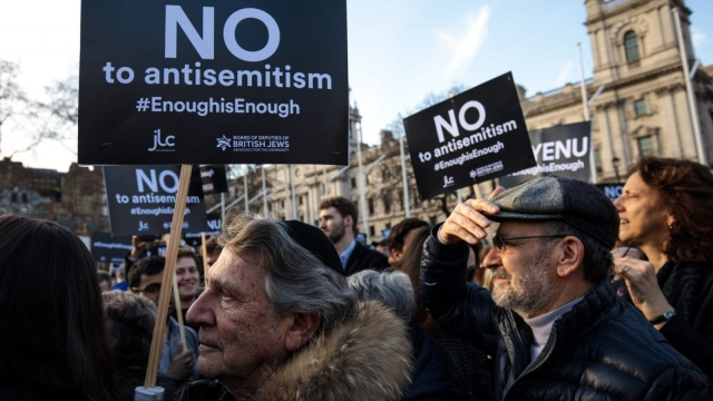 Protesters hold placards as they demonstrate in Parliament Square against anti-Semitism. (Photo by Jack Taylor/Getty Images)