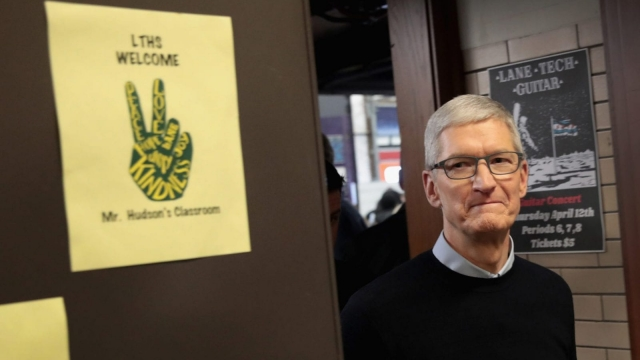 CHICAGO, IL - MARCH 27: Apple CEO Tim Cook tours labs to view demonstrations of apps during an event held to introduce the new 9.7-inch Apple iPad at Lane Tech College Prep High School on March 27, 2018 in Chicago, Illinois. The device will work with Apple Pencil and is available now. (Photo by Scott Olson/Getty Images)