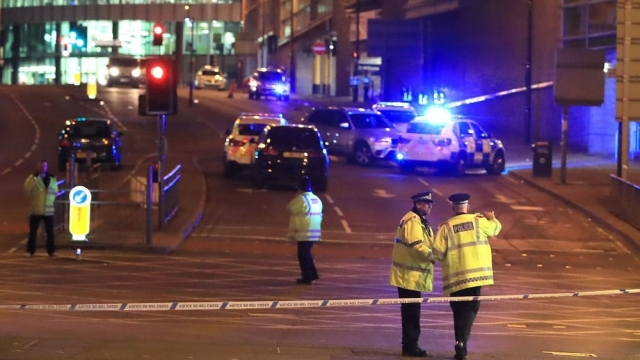 Article thumbnail: Emergency services at Manchester Arena after last year's terror attack at an Ariana Grande concert. (Photo: Peter Byrne/PA Wire)