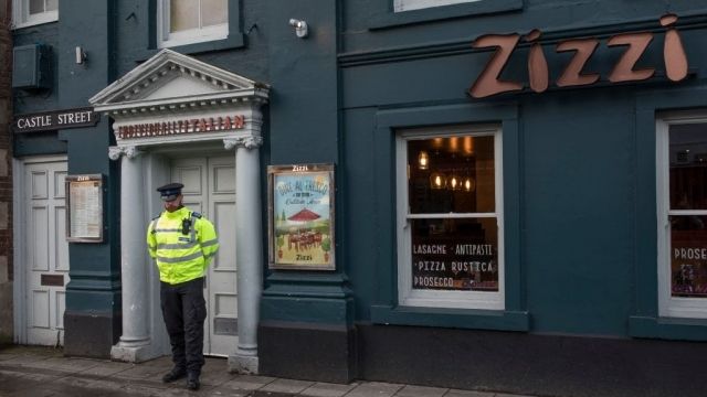A police officer stands outside the temporarily closed Zizzi restaurant in the centre of Salisbury.(Photo by Dan Kitwood/Getty Images)