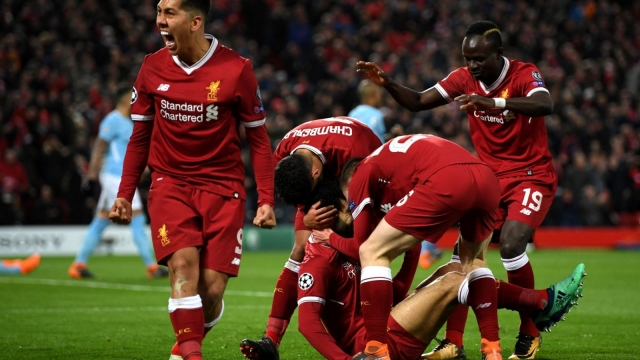 Roberto Firmino celebrates Liverpool's opener against Manchester City with his teammates