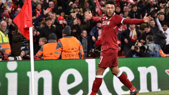 Alex Oxlade-Chamberlain celebrates scoring against Manchester City in the Champions League
