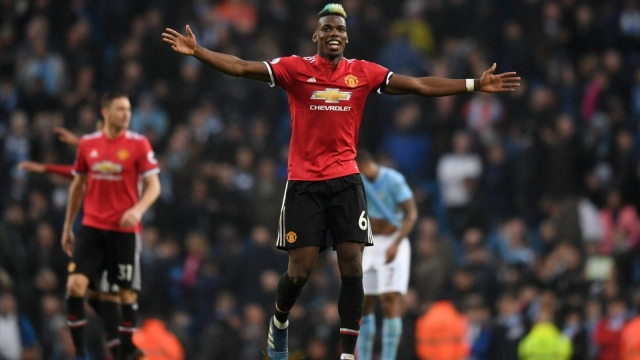 Paul Pogba celebrates Manchester United's derby win at the final whistle