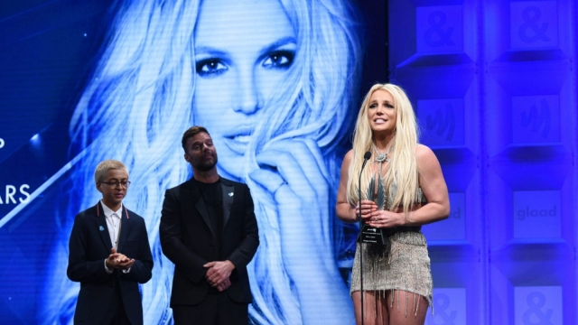 Honoree Britney Spears accepts the Vanguard Award from Ricky Martin and J.J. Totah onstage at the 29th Annual GLAAD Media Awards