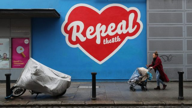 A woman passes a mural in Dublin's Temple Bar calling for repeal of the Eighth Amendment of the Irish Constitution (Photo: PA)
