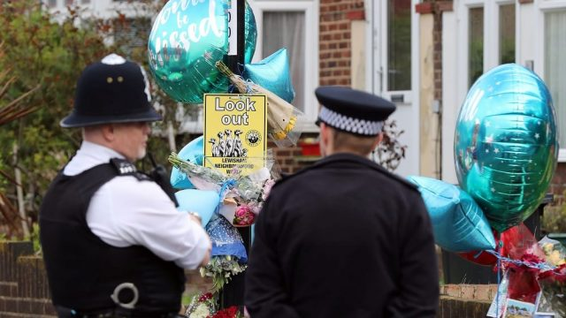 Article thumbnail: Police officers at the scene on South Park Crescent in Hither Green, London after floral and birthday tributes were left today for Henry Vincent. (Photo: Gareth Fuller/PA Wire)