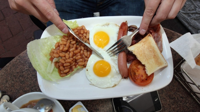 An England fan eats an full English breakfast on 17 June 2010 in Cape Town, South Africa.