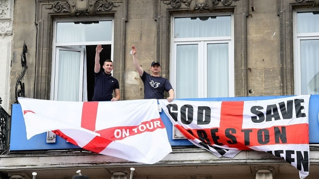 Supporters drape their hotel room balcony with flags in Lille in 2016 (Photo: Getty)