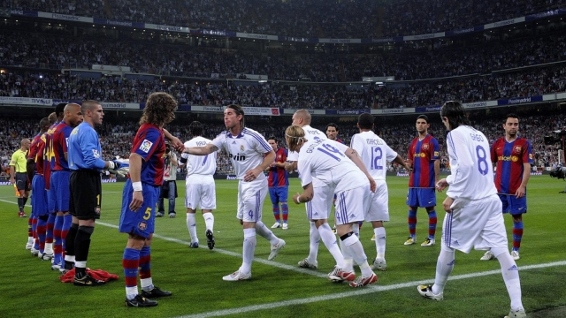 Barcelona players forming a guard of honour for then-La Liga champions Real Madrid on 7 May 2008 in Madrid, Spain