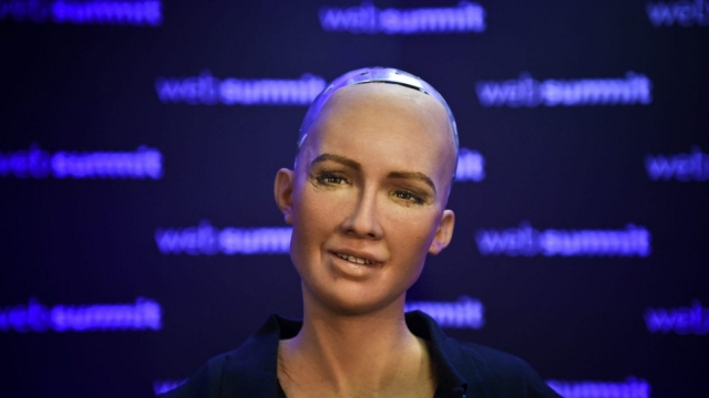 "Humanoid ""Sophia The Robot"" of Hanson Robotics answers questions during a press conference at the 2017 Web Summit in Lisbon on November 7, 2017. Europe's largest tech event Web Summit is held at Parque das Nacoes in Lisbon from November 6 to November 9. / AFP PHOTO / PATRICIA DE MELO MOREIRA (Photo credit should read PATRICIA DE MELO MOREIRA/AFP/Getty Images)"