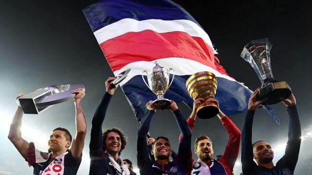 Paris Saint-Germain's Julian Draxler, Adrien Rabiot, Thiago Silva, Kevin Trapp and Layvin Kurzawa celebrate after winning the French Ligue 1 title