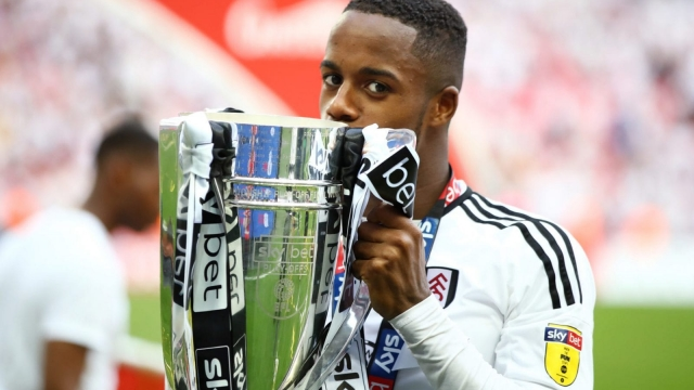 Ryan Sessegnon of Fulham celebrates with the trophy following their sides victory in the Sky Bet Championship Play Off Final on 26 May 26, 2018.