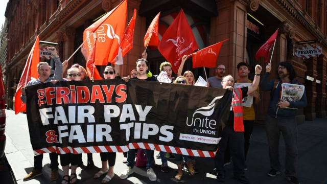 Workers from the Covent Garden branch of TGI Fridays in London on the picket line (Photo: PA)