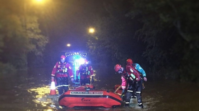 Members of the Technical Rescue Unit of West Midlands Fire Service with a boat in Birmingham after more than a month's rainfall deluged parts of Birmingham in just one hour on Sunday (PA)