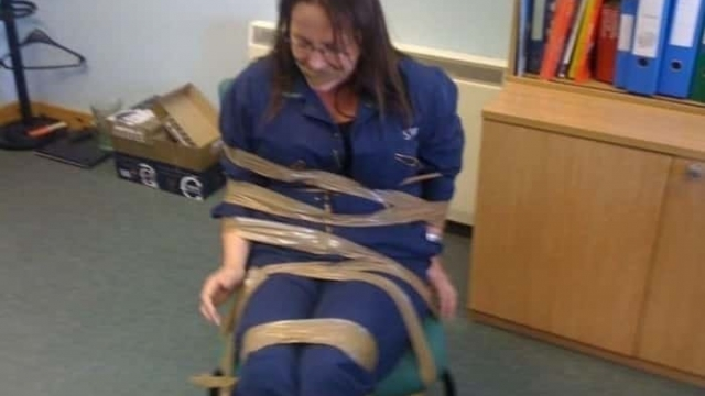 Fisheries officer DeeAnn Fitzpatrick pictured sellotaped to a chair. (Photo: BBC)