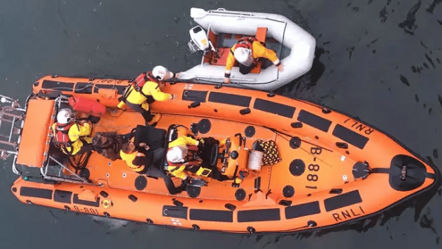 Hartlepool RNLI inshore lifeboat with the two casualties on board and the dinghy alongside at the Ferry Road lifeboat station where a crew member assisted with the recovery. (RNLI/Tom Collins)