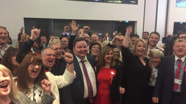 Labour councillors in Trafford celebrate as the Conservatives lose overall control of the council. (PA Wire)