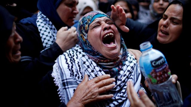 A relative mourns during the funeral of Palestinian nurse Razan Al-Najar. (Photo: Reuters)