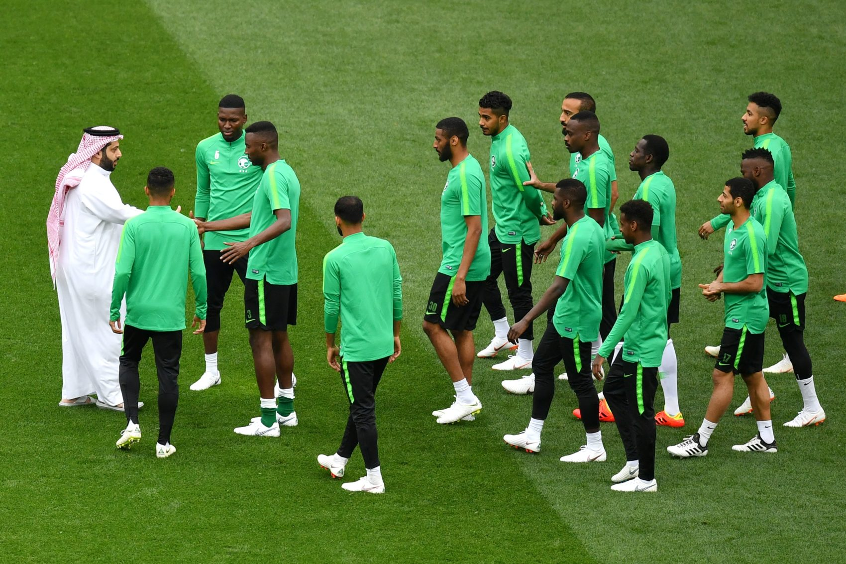 Saudi Arabia sports minister Turki al-Sheikh greets his nation's players ahead of the World Cup's opening game against hosts Russia