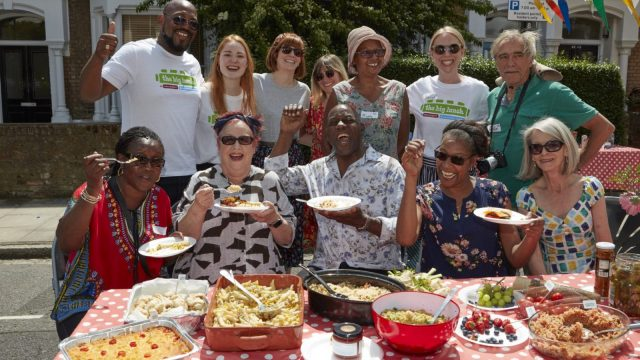 Jo Brand (front, second from left) joins Ainsley Harriott (second from right) at a Hackney street party during the Big Lunch. (Image: The Big Lunch)