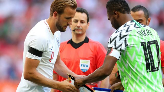 England captain Harry Kane exchanges handshakes with Nigeria's John Obi Mikel ahead of England's 2-1 friendly win on 2 June