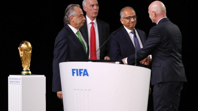 Fifa president Gianni Infantino (right) poses with the United 2026 World Cup bid (Getty Images)