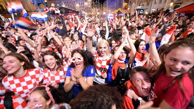 Croatia'sfans celebrate a goal as they watch on a giant screen the Russia 2018 World Cup Group D football match between Iceland and Croatia (Photo: Getty)