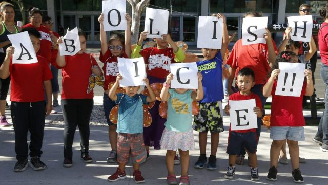 Children hold up signs during an immigration family separation protest in front of the Sandra Day O'Connor U.S. District Court building in Phoenix. An unapologetic President Donald Trump defended his administration's border-protection policies Monday in the face of rising national outrage over the forced separation of migrant children from their parents. (AP Photo/Ross D. Franklin)