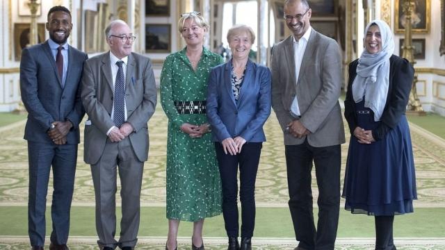 Recipients of the Queen's Birthday Honours list, (left to right) Jermain Defoe, John Davies, Jo Malone, Kathleen Moore, Thomas Ilube and Akeela Ahmed. (Photo: Victoria Jones/PA Wire)