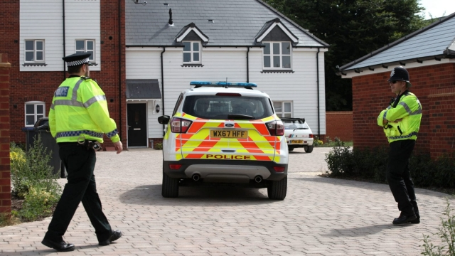 Police activity outside a block of flats on Muggleton Road in Amesbury, Wiltshire, where a major incident has been declared after it was suspected that two people might have been exposed to an unknown substance. PRESS ASSOCIATION Photo. Picture date: Wednesday July 4, 2018. Police say that the man and woman, both in their 40s, are in a critical condition at Salisbury District Hospital. See PA story POLICE Amesbury (Photo: Yui Mok/PA Wire)