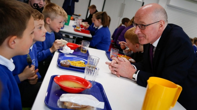 John Swinney said claiming free school meals could be hard for parents with children at smaller schools (Photo: Scottish Government)