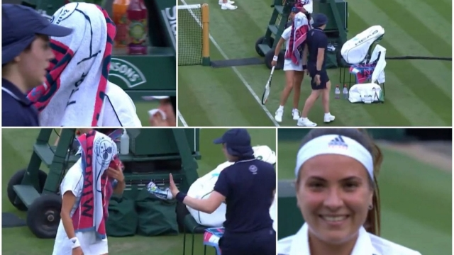 Romania's Elena-Gabriela Ruse walks into a ball boy while she wears a towel over her head in her first round match against Poland's Agnieszka Radwanska in the first round of Wimbledon 2018. (BBC)