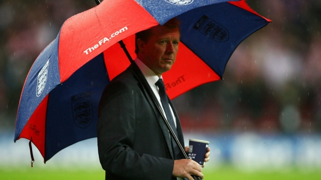 Steve McClaren manager of England looks on from under his umbrella at Wembley Stadium on 21 November 2007. (Getty Images)