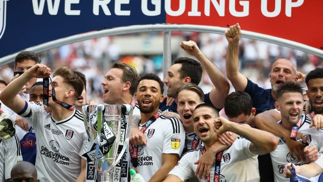 Fulham players celebrate winning last season's play-off final (Photo by Clive Mason/Getty Images)