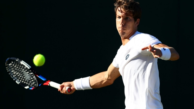 Ex-Brit Aljaz Bedene of Slovenia en route to victory over converted Brit Cameron Norrie in the first round at Wimbledon. (Photo by Matthew Lewis/Getty Images)