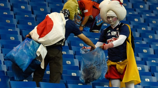 Japan supporters collect rubbish after the Russia 2018 World Cup round of 16 match against Belgium at the Rostov Arena on 2 July 2018.