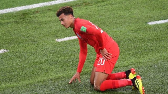 Dele Alli of England goes down injured during the World Cup round-of-16 match against Colombia