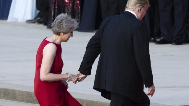 Britain's Prime Minister Theresa May welcomes U.S. President Donald Trump at Blenheim Palace
