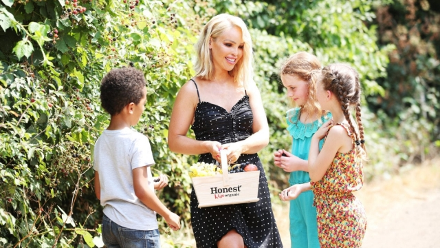 TV personality Katie Piper surprises a group of children with a trip to a farm (SWNS)