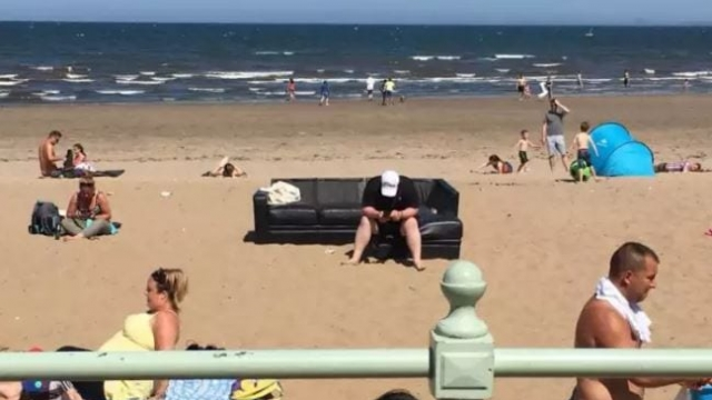 Not content with simply taking a towel, he hauled a leather three-seater sofa to the beach (Photo: @gigiglasgow72/Twitter)