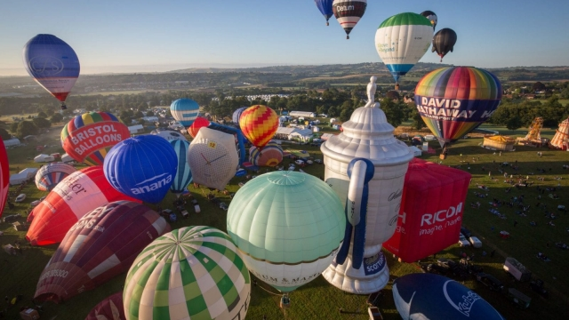 Hot air balloons rise into the morning sky from the Bristol International Balloon Fiesta. Photo: Getty