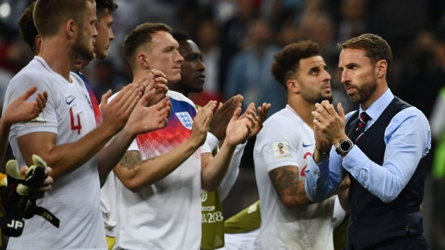 England's coach Gareth Southgate and players greet the supporters after their defeat during the Russia 2018 World Cup semi-final match (AFP/Getty)