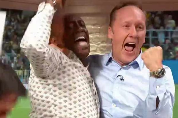 ITV pundits Ian Wright and Lee Dixon celebrate England's penalty shoot-out win over Colombia