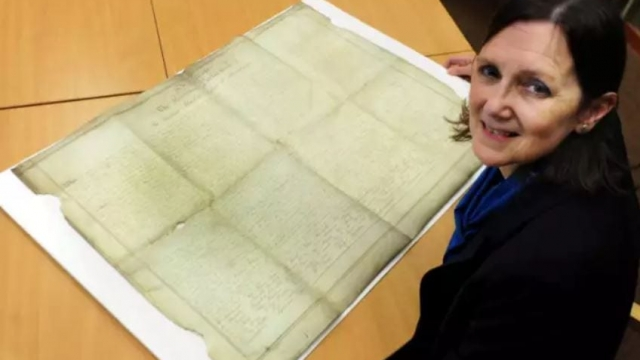 Wendy Walker, county archivist, with the document (Photo: JPress)